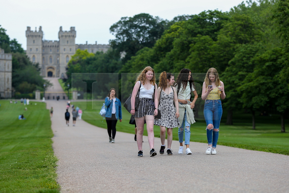 © Licensed to London News Pictures. 01/07/2021. Windsor, UK. Members of public on The Long Walk leading to Windsor Castle on a warm and sunny day. Next week parts of the UK will see temperatures rise to more than 20 degrees celsius. Photo credit: Dinendra Haria/LNP