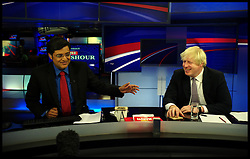 London mayor Boris Johnson talks to India's equivalent of David Letterman, Arnab Goswami. Goswami one of India's most prominent chat show hosts as he appears on one of the country's most famous current affairs programmes, as part of a week long tour of India where he is trying to persuade Indian businesses to invest in London, Friday November 30, 2012. Photo by Andrew Parsons / i-Images