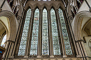 """The Five Sisters Window in the North Transept of York Minster is the only memorial in the country to women of the British Empire who lost their lives during the First World War. The window, which dates from the mid-1200s, was restored and rededicated between 1923 and 1925 after it was removed during the First World War to protect it during Zeppelin raids. York Minster, built over 250 years 1220-1472 AD, is one of the finest medieval buildings in Europe. Also known as St Peter's, its full name is """"Cathedral and Metropolitical Church of St Peter in York,"""" located in England, United Kingdom, Europe. York Minster is the seat of theArchbishop of York, the second-highest office of the Church of England.""""Minster"""" refers to churches established in the Anglo-Saxon period as missionary teaching churches, and now serves as an honorific title.York was founded by the Romans as Eboracum in 71 AD. As the center of the Church in the North, York Minster has played an important role in great national affairs, such as during the Reformation and Civil War."""