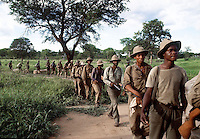 Heavily armed ZIPRA guerilla fighters seen arriving at Assembley Point Papa in Rhodesia in 1980 for the elections. Photographed by Terry Fincher