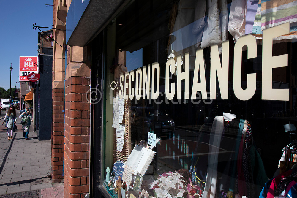 Second Chance second hand shop on Ladypool Road in Birmingham, United Kingdom. This area is predominantly inhabited by Asian families. Sparkbrook has the second highest non-white population in Birmingham, with minority ethnic residents living in the area; notably it is home to a large Somali population. Sparkbrook is also the location of Birminghams Balti Triangle, as many of the residents have their own balti businesses.