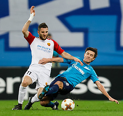 November 23, 2017 - Saint Petersburg, Russia - Yuri Zhirkov (R) of FC Zenit Saint Petersburg and Tigran Barseghyan of FK Vardar vie for the ball during the UEFA Europa League Group L match between FC Zenit St. Petersburg and FK Vardar at Saint Petersburg Stadium on November 23, 2017 in Saint Petersburg, Russia. (Credit Image: © Mike Kireev/NurPhoto via ZUMA Press)