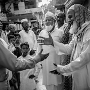 Muslim religious and community leaders shake hands with unicef staff after a successfu meeting. unicef staff regularily meet mulanas and leaders of the muslim community to sensitize them about the campaign and promote cooperation at local community level.