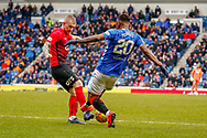 Alfredo Morelos lunges for the ball on the edge of the box during the Ladbrokes Scottish Premiership match between Rangers and Kilmarnock at Ibrox, Glasgow, Scotland on 16 March 2019.