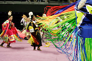 Dancers, adorned in their finest regalia, competed for prizes in a variety of men's and women's categories to the sounds of drumming and singing at the First Nations Pow Wow in Seattle, Washington on April 14, 2007. Dancers, drummers and singers from tribes across North America gather every year at the University of Washington to compete in the weekend long celebration.
