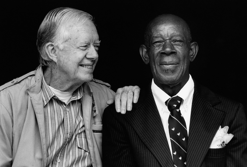 Former president Jimmy Carter pictured with his friend and neighbor Curtis Jackson.  The two men helped to build a Habitat home for Mr. Jackson's family.