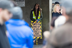 © Licensed to London News Pictures. 31/10/2020. Manchester, UK. A woman holds a sign as people gather at Piccadilly Gardens, Manchester for an anti-lockdown protest, with guest speaker Piers Corbyn. Photo credit: Kerry Elsworth/LNP