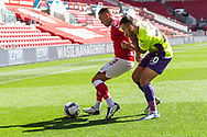 Bristol City's Jack Hunt (2) and Exeter City's Lewis Page (20) in action during the EFL Cup match between Bristol City and Exeter City at Ashton Gate, Bristol, England on 5 September 2020.