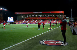 General view of Charlton Athletic's manager Karl Robinson watching the players warming up before the game