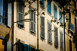 Typical French shuttered windows on a property in the Place Carnot in the town of Carcassonne, France<br /> <br /> (c) Andrew Wilson   Edinburgh Elite media