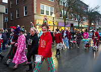 Kimberly Monfet joins her fellow Who's with the Galleria marchers and float during the Light Up Laconia Holiday Parade on Sunday.  (Karen Bobotas/for the Laconia Daily Sun)
