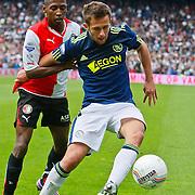 NLD/Rotterdam/20100919 - Voetbalwedstrijd Feyenoord - Ajax 2010, Miralem Sulejmani in duel met
