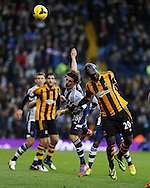 Billy Jones of West Brom © is challenged by Hull city's Yannick Sagbo (r). Barclays Premier league, West Bromwich Albion v Hull city at the Hawthorns in West Bromwich, England on Saturday 21st Dec 2013. pic by Andrew Orchard, Andrew Orchard sports photography.