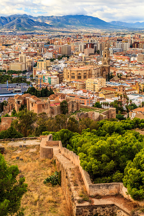The old Muslim castle Gibralfaro in Malaga, Spain. A long barbican connects the higher sitting Gibralfaro to lower Muslim palace-fortress, Alcazaba.