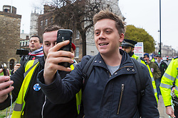 Smiling left wing social and political commentator and journalist Owen Jones is harassed as he walks through Old Palace Yard and past College Green opposite the Houses of Parliament by pro-leave protesters, the same group responsible for harassing pro remain Tory backbencher Anna Soubry, hurling insults and calling him a traitor. London, January 07 2019.