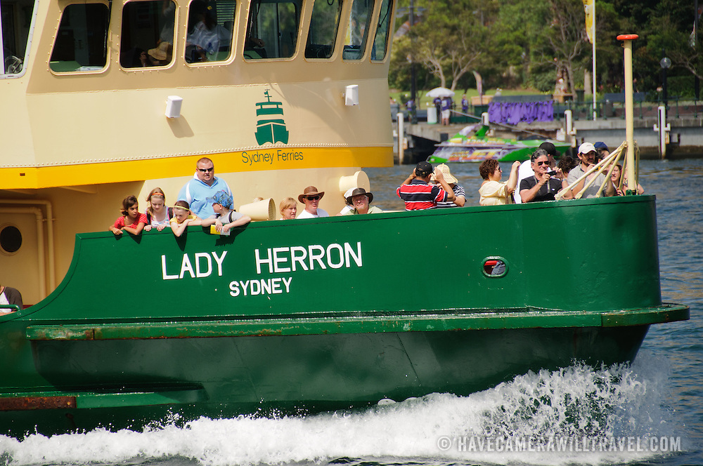 Passengers on deck of a Sydney Harbour Ferry (Lady Herron) heading out from Circular Quay