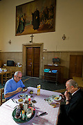 Riccardo Casagrande, monk brother priest eats with a colleague at the San Marcello al Corso Church in Rome, Italy, near the Spanish Steps. (Riccardo Casagrande is featured in the book What I Eat: Around the World in 80 Diets.) Casagrande is in charge of the kitchen, garden, and wine cellar for the brotherhood.