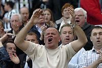 Photo. Glyn Thomas.Digitalsport<br /> Newcastle United v Olympique de Marseille. <br /> UEFA Cup Semi Final, First Leg. 22/04/2004.<br /> Newcastle fans urge on their team in this vital match.