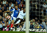Photo: Ed Godden.<br /> Portsmouth v Bolton Wanderers. The Barclays Premiership. 25/09/2006. Bolton's El-Hadji Diouf (R) is brought to the ground by Gary O'Neil.