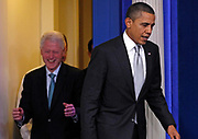 U.S. President Barack Obama and former President Bill Clinton arrive to speak to the press in the Brady Press Briefing Room at the White House in Washington, December 10, 2010. Clinton endorsed Obama's deal with Republicans to extend Bush-era tax cuts after the two men met at the White House on Friday. <br /> REUTERS/Jim Young