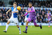 Plymouth Argyle's Reuben Reid and Bristol Rovers Tom Lockyer race to the ball during the Sky Bet League 2 match between Bristol Rovers and Plymouth Argyle at the Memorial Stadium, Bristol, England on 23 January 2016. Photo by Shane Healey.
