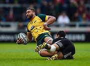 Australia second-row Lukhan Lealaiaulolo-Tui is tackled by New Zealand fly-half Stephen Perofeta during the World Rugby U20 Championship 5rd Place play-off  match Australia U20 -V- New Zealand U20 at The AJ Bell Stadium, Salford, Greater Manchester, England on Saturday, June  25  2016.(Steve Flynn/Image of Sport)