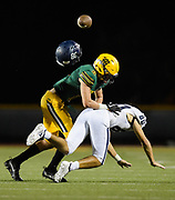 Higley's Jaxen Gibbons, right, looses his helmet after being hit by Moorpark's Ian Meier at Moorpark High School on Sept. 8 2018.