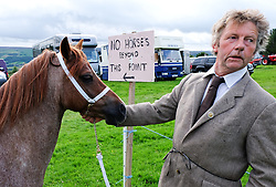 © Licensed to London News Pictures.26/08/15<br /> Egton, UK. <br /> <br /> A man waits with his horse before entering the main arena at the 126th Egton Show in North Yorkshire. <br /> <br /> Egton is one of the largest village shows in the country and is run by a band of voluntary helpers. <br /> <br /> This year the event featured wrought iron and farrier displays, a farmers market, plus horse, cattle, sheep, goat, ferret, fur and feather classes. There was also bee keeping, produce and handicrafts on display.<br /> <br /> Photo credit : Ian Forsyth/LNP