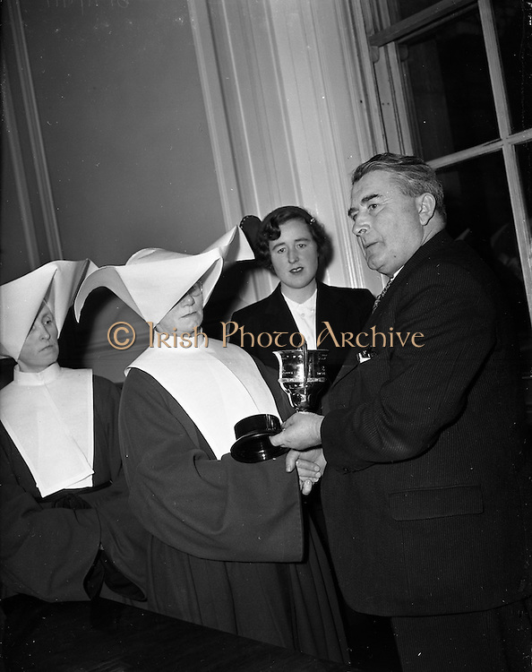 14/01/1953<br /> 01/14/1953<br /> 14 January 1953<br /> Department of Agriculture egg-laying Competition, presentation of Silver Cup to St. Martha's College, Sion House in Navan, County Meath.