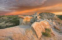 Clearing storm at sunrise over badlands sandstone formations, Theodore Rossevelt National Park, North Dakota