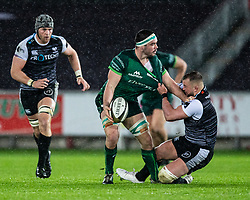 Paul Boyle of Connacht offloads despite the attentions of Sam Parry of Ospreys<br /> <br /> Photographer Simon King/Replay Images<br /> <br /> Guinness PRO14 Round 6 - Ospreys v Connacht - Saturday 2nd November 2019 - Liberty Stadium - Swansea<br /> <br /> World Copyright © Replay Images . All rights reserved. info@replayimages.co.uk - http://replayimages.co.uk