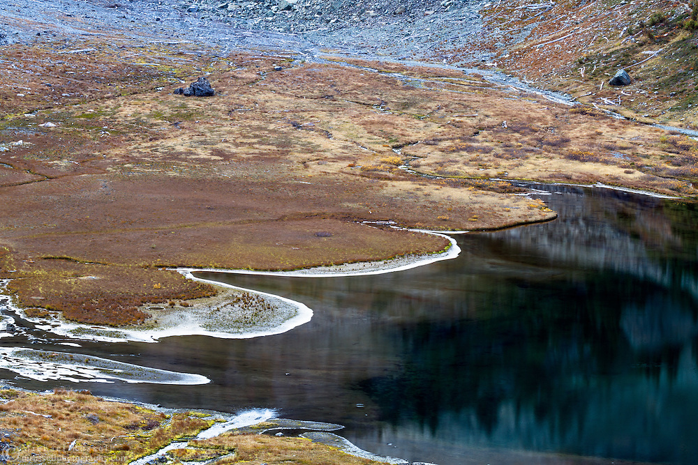 The shoreline of Bagley Lake below table mountainl. Photographed in October from the Heather Meadows Recreation area of the Mount Baker-Snoqualmie National Forest, Washington State, USA.
