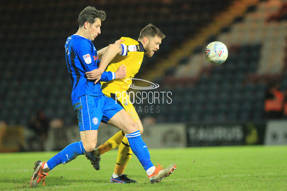 Jim McNulty wins the ball during the EFL Sky Bet League 1 match between Rochdale and Oxford United at Spotland, Rochdale, England on 12 March 2019.