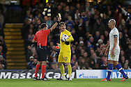 Referee Cuneyt Cakir of Turkey books Goalkeeper Iker Casillas of FC Porto for diving.  UEFA Champions league group G match, Chelsea v Porto at Stamford Bridge in London on Wednesday 9th December 2015.<br /> pic by John Patrick Fletcher, Andrew Orchard sports photography.