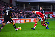 Jacob Brown of Barnsley (33) passes the ball forward under pressure from Jack Payne of Bradford City (10) and Adam Chicksen of Bradford City (3) during the EFL Sky Bet League 1 match between Barnsley and Bradford City at Oakwell, Barnsley, England on 12 January 2019.