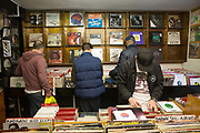 People shopping for vinyl in a record shop on 2nd November 2015 in London, United Kingdom. Music and Video Exchange is one of the few surviving record shops based Notting Hill, West London