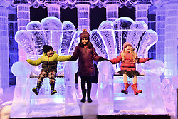 © Licensed to London News Pictures. 16/11/2017. London, UK. Jack Dury aged 3, Gabrielle Nijjer aged 6 and Ruby Darrah aged 3 sit and stand on the thrones of a large ice sculpture on display as part of the Deep Sea Adventure. The Magical Ice Kingdom is the largest indoor ice and snow sculpture experience in Europe and part of the Hyde Park Winter Wonderland. Photo credit: Ray Tang/LNP