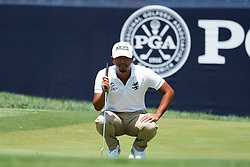 August 10, 2018 - St. Louis, Missouri, United States - Satoshi Kodaira lines up a putt on the 9th green during the second round of the 100th PGA Championship at Bellerive Country Club. (Credit Image: © Debby Wong via ZUMA Wire)