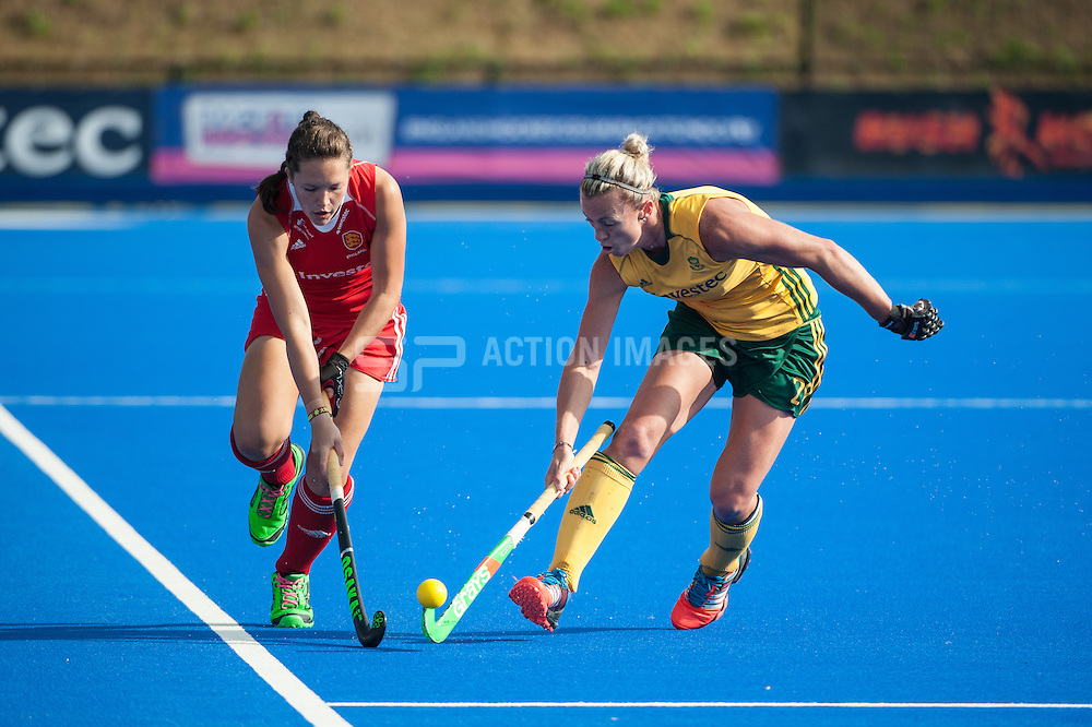 England's Ellie Watton is challenged by Tarryn Bright of South Africa during the Final of the Investec London Cup. Lee Valley Hockey & Tennis Centre, London, UK on 13 July 2014. Photo: Simon Parker