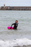Award winning actress and Folkestone resident Jessica Hynes walks out of the sea after completing a 4 mile sea swim on the 7th of July 2020 with 12 laps of Folkestone sunny sands bay to raise money for charity in Folkestone, Kent. She swam for two different charities, one being the Folkestone community hub, which has been supporting vulnerable people during the Covid-19 lockdown and the second called Green Kordofan which supports children in a refugee camp in Yida, South Sudan. Mrs Hynes is one of many volunteers who have worked at the hub, which provides help by delivering groceries, collecting prescriptions or just being a voice on the end of the phone.The second charity is Green Kordofan, which supports children in a refugee camp in Yida, South Sudan and was founded by Raga Gibreel, also from Folkestone.The registered charity is currently raising money for essential hygiene facilities such as washing and toilet blocks, to make the camp safe for the children who have been displaced by war. (photo by Andrew Aitchison / In pictures via Getty Images)