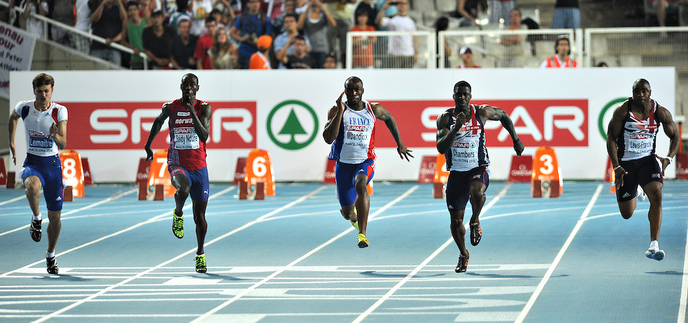 Athletes compete in the men's 100m final at the 2010 European Athletics Championships at the Olympic Stadium in Barcelona