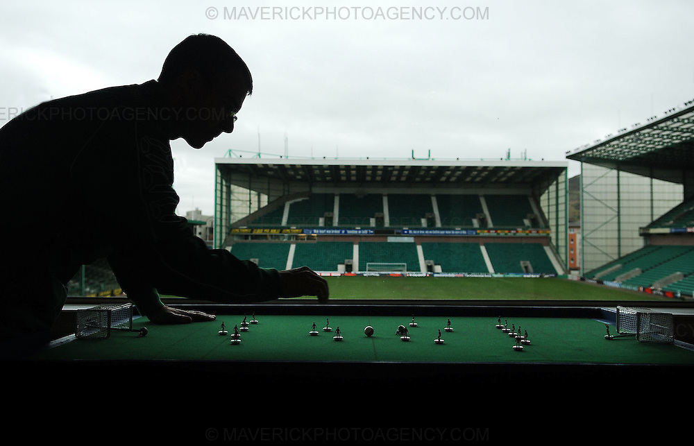 Easter Road is to play host to one of the year's biggest football tournaments with teams from all over the world descending on the Hibs ground this weekend for the Subbuteo Table Soccer event of the year...Three of the world's top five teams will be taking part in the event. The Scottish Sports Table Football Association (SSTFA) are hosting the event organised by Mike Burns, president of the SSTFA...Pic shows David Baxter practicing his Subbuteo skills with Hibernian FC stadium in the background...Picture Richard Scott/Maverick
