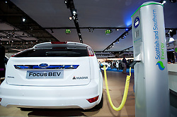 Plug in electric car being recharged at Frankfurt Motor Show 2009