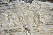 Petroglyph, rock carving, of two warriors one wearing a helmet and carrying a sword and shield. Carved by the ancient Camuni people in the iron age between 1000-1600 BC. Rock no 24,  Foppi di Nadro, Riserva Naturale Incisioni Rupestri di Ceto, Cimbergo e Paspardo, Capo di Ponti, Valcamonica (Val Camonica), Lombardy plain, Italy .<br /> <br /> Visit our PREHISTORY PHOTO COLLECTIONS for more   photos  to download or buy as prints https://funkystock.photoshelter.com/gallery-collection/Prehistoric-Neolithic-Sites-Art-Artefacts-Pictures-Photos/C0000tfxw63zrUT4<br /> If you prefer to buy from our ALAMY PHOTO LIBRARY  Collection visit : https://www.alamy.com/portfolio/paul-williams-funkystock/valcamonica-rock-art.html