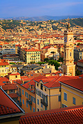 Buildings in the old town part of Nice, France.<br /> .....<br /> Nice is the fifth most populous city in France, after Paris, Marseille, Lyon and Toulouse, and it is the capital of the Alpes Maritimes département. The urban area of Nice extends beyond the administrative city limits with a population of about 1 million on an area of 278 sq mi. Located on the south east coast of France on the Mediterranean Sea, Nice is the second-largest French city on the Mediterranean coast and the second-largest city in the Provence-Alpes-Côte d'Azur region after Marseille.<br /> <br /> The city is called Nice la Belle, which means Nice the Beautiful, which is also the title of the unofficial anthem of Nice, written by Menica Rondelly in 1912. The area of today's Nice contains Terra Amata, an archaeological site which displays evidence of a very early use of fire. Around 350 BC, Greeks of Marseille founded a permanent settlement and called it Nikaia, after Nike, the goddess of victory. Through the ages, the town has changed hands many times. Its strategic location and port significantly contributed to its maritime strength. For years it was a dominion of Savoy, then became part of France between 1792 and 1815, when it was returned to Piedmont-Sardinia until its reannexation by France in 1860.<br /> <br /> The natural beauty of the Nice area and its mild Mediterranean climate came to the attention of the English upper classes in the second half of the 18th century, when an increasing number of aristocratic families took to spending their winter there. The city's main seaside promenade, the Promenade des Anglais ('the Walkway of the English') owes its name to the earliest visitors to the resort. For decades now, the picturesque Nicean surroundings have attracted not only those in search of relaxation, but also those seeking inspiration. The clear air and soft light has been of particular appeal to some of Western culture's most outstanding painters, such as Marc Chagall, Henri Matisse, Niki de Saint Phalle and Arm
