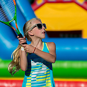 August 19, 2014, New Haven, CT:<br /> A girl hits a tennis ball during a Girl Scout Night clinic on day five of the 2014 Connecticut Open at the Yale University Tennis Center in New Haven, Connecticut Tuesday, August 19, 2014.<br /> (Photo by Billie Weiss/Connecticut Open)