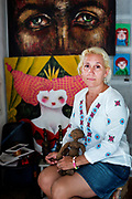 """Artist and photographer, Ismary Gonzalez Cabrera, 48, is photographed in her studio in Old Havana. """"My parents were devoted to the revolution and were quite absent so I had a lonely childhood,"""" she says. She has one child, Pablo, and tries to share her experiences through her art. """"I'm so happy that I have been able to make art my career. I know many artists struggle to live off their art and to me it is my greatest achievement,"""" she adds. She dreams of traveling to other countries and experiencing other cultures but knows that isn't realistic at the moment. Of Cuban women, she says, """"We are warriors. Like everyone, we need love, we need family and we need work."""""""