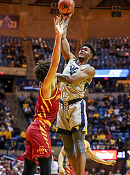Mar 6, 2019; Morgantown, WV, USA; West Virginia Mountaineers forward Derek Culver (1) shoots during the second half against the Iowa State Cyclones at WVU Coliseum. Mandatory Credit: Ben Queen-USA TODAY Sports