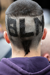 """© Licensed to London News Pictures. 06/06/2020. Manchester, UK. A man with """" B L M """" cut in to his hair . Tens of thousands attend a Black Lives Matter demonstration against police violence , centred in Piccadilly Gardens in Manchester City Centre . Protests have and are being held around the world , after George Floyd was killed whilst being restrained by police in Minneapolis on 25th May 2020 . Photo credit: Joel Goodman/LNP"""