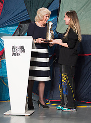 The Duchess of Cornwall (left) presents Bethany Williams with the Queen Elizabeth II Award for Design during a visit to London Fashion Week at the BFC Show Space, London.